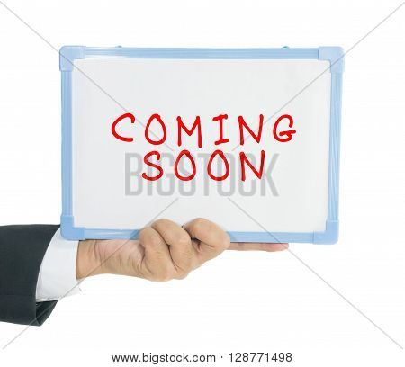 Coming soon text write on white board