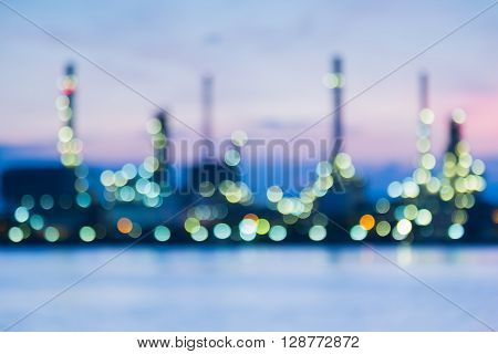 Abstract blurred bokeh lights, refinery waterfront during sunrise