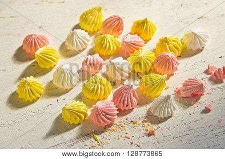 traditional French pastries meringue on wooden table
