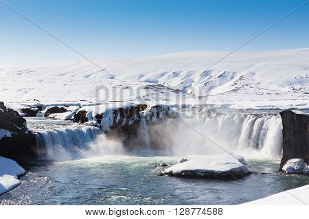 Beautiful big waterfall and clear blue sky in winter, Iceland landscape