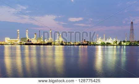 Panorama landscape, Oil refinery with river reflection before sunrise