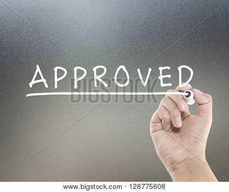 approved text on glass board with hand writing
