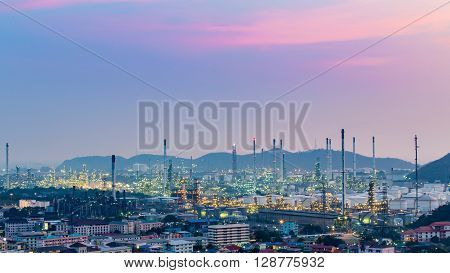 Sunset sky over oil refinery and mountain background