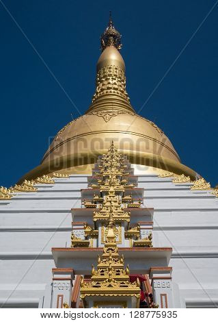 Gold pagoda with blue sky in Myanmar