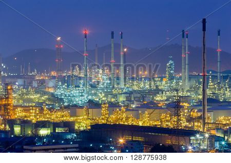 Twilight over oil refinery lights, night view
