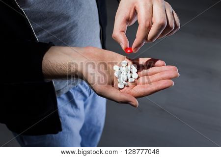 Man Taking Red Pill