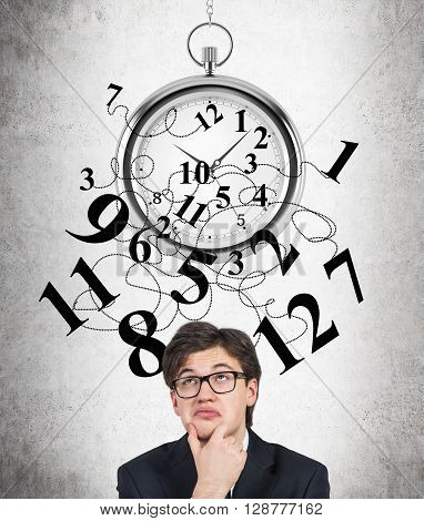 Time management with broken clock and thinking businessman with funny expression on concrete background