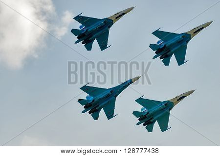 Nizhniy Tagil, Russia - July 12. 2008: Group flight of russian highest pilotage team on SU-27. Display of fighting opportunities of equipment with application of aviation means of defeat
