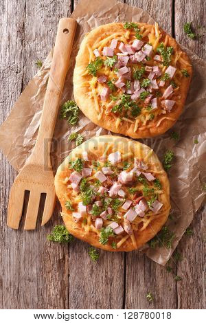 Langos Deep Fried With Cheese And Ham Close-up. Vertical Top View