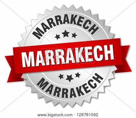Marrakech round silver badge with red ribbon