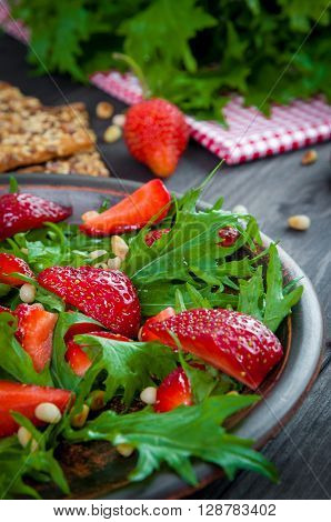 Useful strawberry salad with arugula nuts and honey