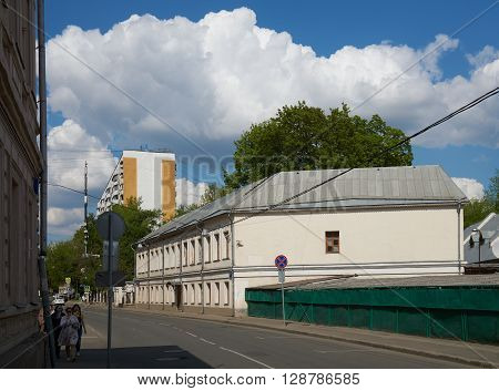 Moscow Russia - May 06 2016: People walking on Tokmakov pereulok (lane) and eating ice-cream in Moscow in springtime.