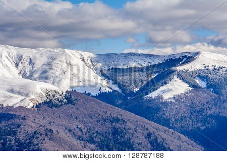 Mountain Peaks Covered With Snow. Horizontal Panoramic View With High Mountains Partial Covered With