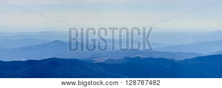 Winter Landscape Over Carpathian Mountains Peaks. Panorama Of Snow Mountain Range Landscape With Blu