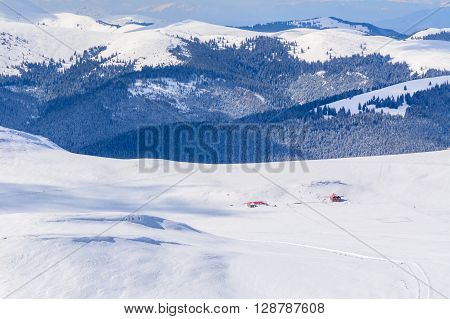 Panoramic View Over Carpathian Mountains In Wintertime.  Winter Alpine Landscape With Covered Peaks,