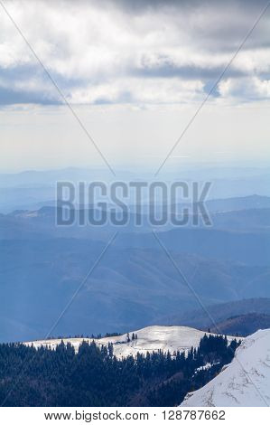 Winter Landscape Over Carpathian Mountains. Vertical View Of Snow Mountain Range Landscape With Blue