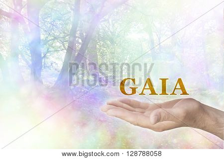 Embrace the GAIA Philosophy - male hand palm up with a gold GAIA word floating above and a rainbow colored bokeh effect woodland scene behind