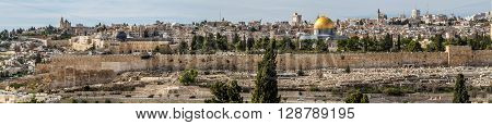 JERUSALEM ISRAEL - JANUARY 5: Panoramic view of the Temple Mount Dome of the Rock and Al Aqsa Mosque from the Mount of Olives in Jerusalem Israel January 5 2016