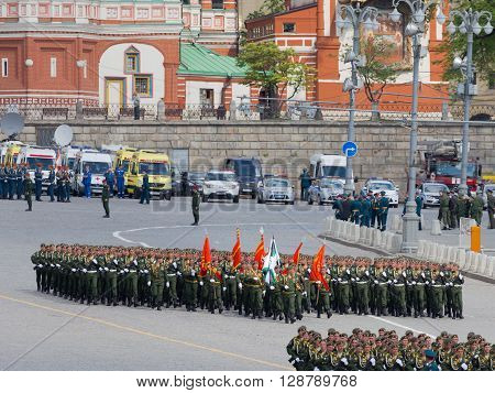 Moscow - May 6 2016: The military lined up in rows and are marching during the final rehearsal of the Victory Parade on Red Square on May 6 2016 Moscow Russia