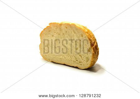 a piece of fresh bread on a white background . Isolate . suitable for bakery.