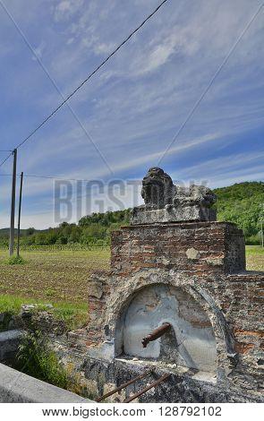 A public drinking water fountain outside the hamlet of Soravilla near Cividale del Friuli Italy
