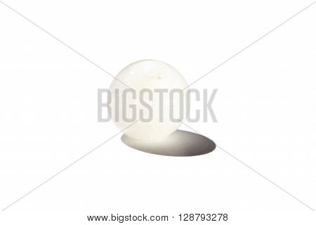 Hand made white glass bead on white background