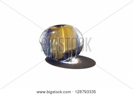 Hand made transparent blue and yellow glass bead on white background
