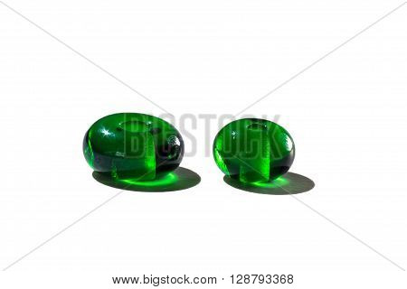 Hand made green transparent glass beads on white background