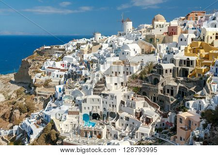 Oia, Greece - April 26, 2016: View of the Oia, a beautiful village on the volcanic island of Santorini in the Mediterranean Sea.