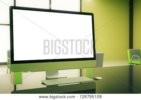 Sideview of blank white computer screen in green office interior. Mock up 3D Rendering