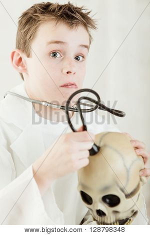 Surprised Boy Checking Skull With Stethoscope