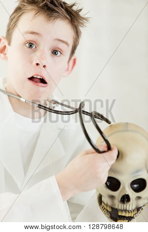 Shocked Young Child Doctor Checking Human Skull