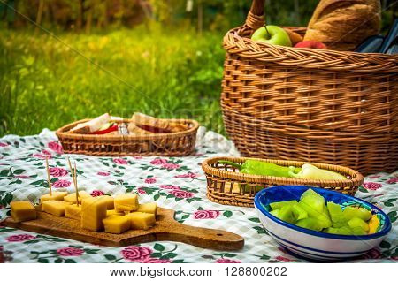 Picnic scene, detail, with cheese and fruit