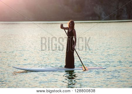 Slender Girl On Stand Up Paddleboard On Sunset Background. Sup01