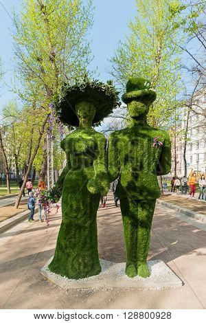 MOSCOW RUSSIA - April 30 2016. Statues made of grass. Street festival
