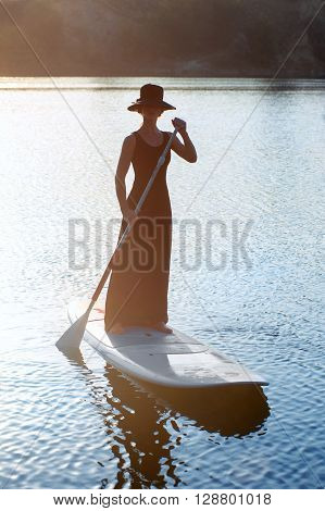 Slender Girl On Stand Up Paddleboard On Sunset Background. Sup03