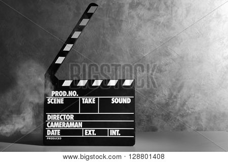 Movie clapper on grey background