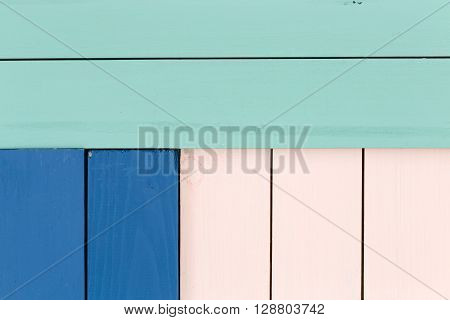 Green, Blue And Rose Colored Stained Wood