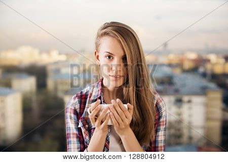 Young Lady Drinking Coffee