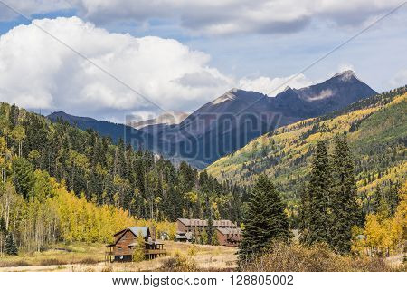 Rural Country view with a rustic building and hotel in the mountains in Colorado, USA