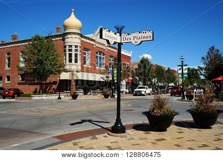 PLAINFIELD, ILLINOIS / UNITED STATES - SEPTEMBER 20, 2015: Street signs mark the corner of Lockport and Des Plaines Streets, in the heart of downtown Plainfield.