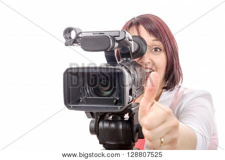 a pretty camerawoman with a professional camera on white