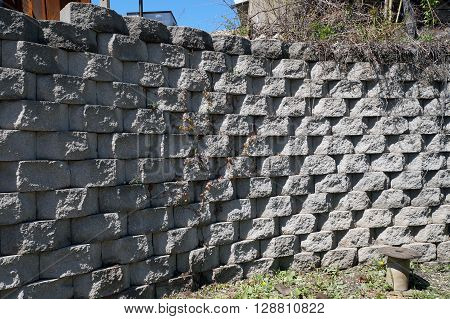 A block retaining wall along the railroad tracks in downtown Joliet, Illinois.