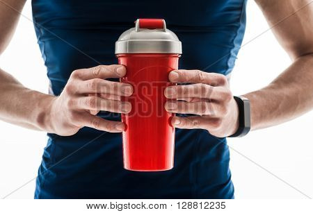 Close up of male hands holding a container of water. Sportsman is standing. Isolated