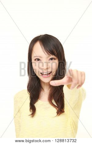 young Japanese woman discover something on white background