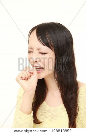 portrait of young Japanese woman coughing on white background