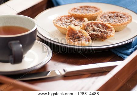 delicious butter tarts with raisins and a flaky crust