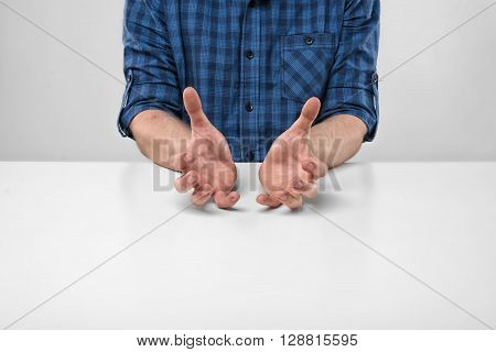 Cropped image of masculine hands showing the size of something. Hand gesture. Bad job. Symbols and gestures. Imitation.