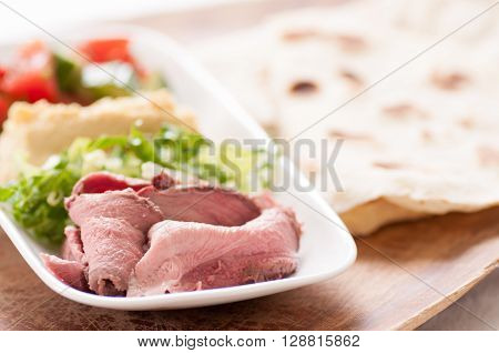rare slice lamb ingredients for a wrap or shawarma