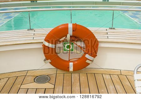 Cruise ship orange life saving preserver ring iconic sailing symbol of the seas